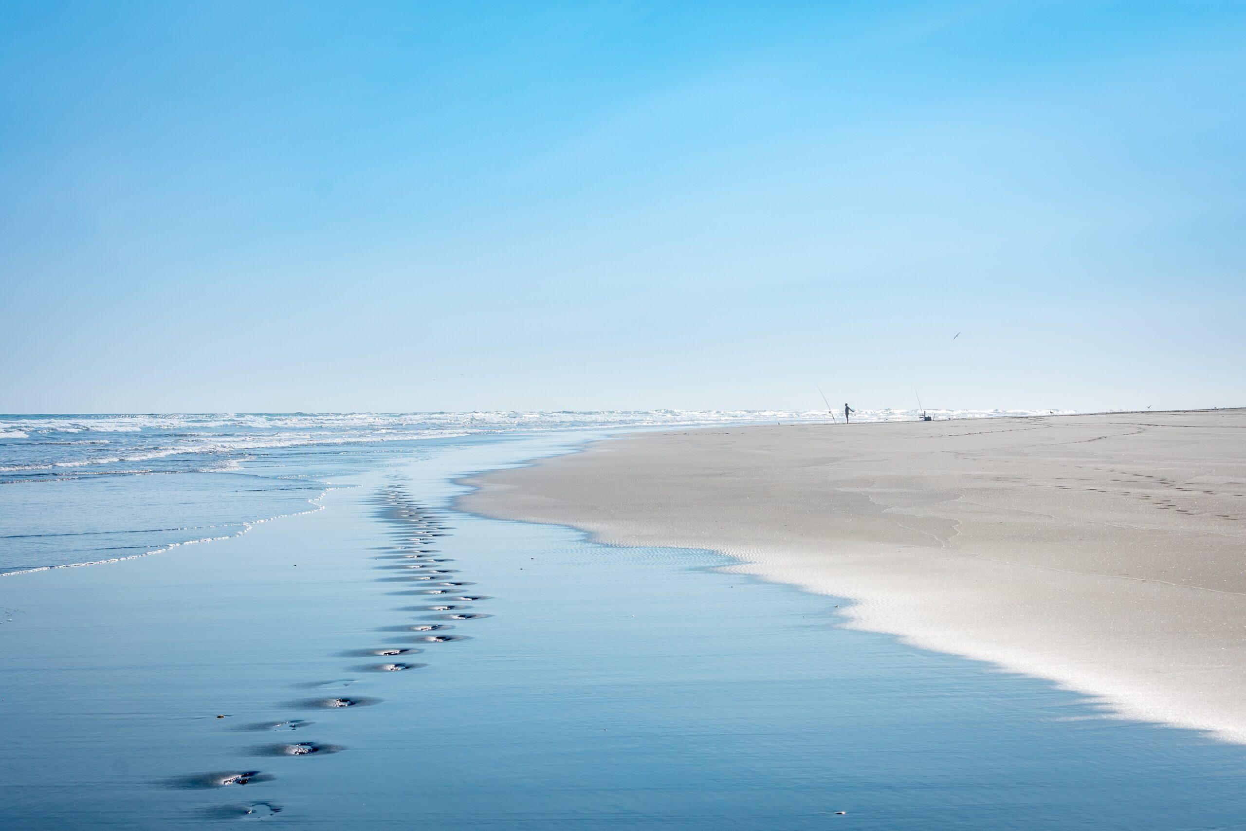 footsteps along a beach