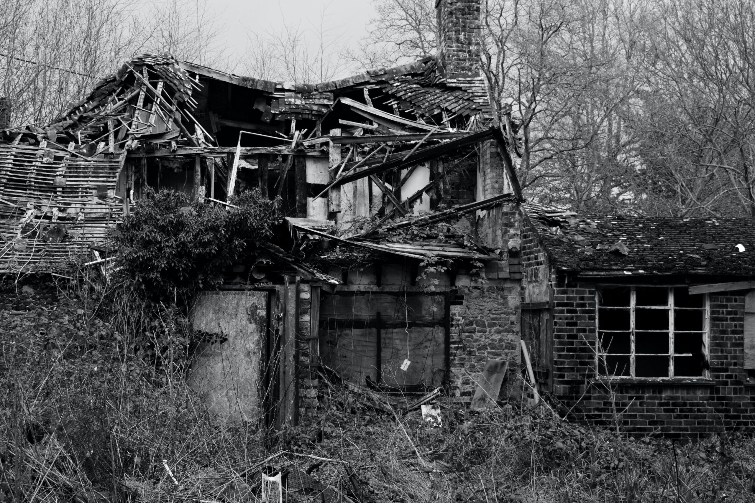 a wrecked home black & white picture